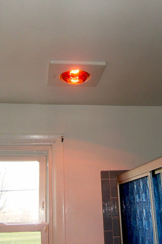 A retro renovation, save the blue bathroom. Heat lamp.