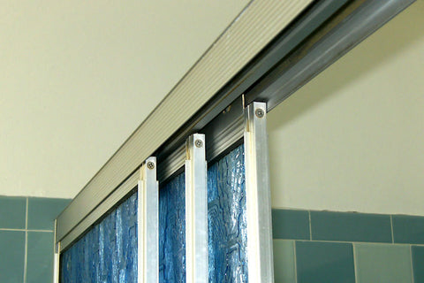 A retro renovation, save the blue bathroom. Sliding glass shower doors.