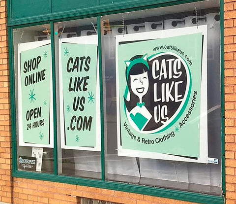 New Cats Like Us signs