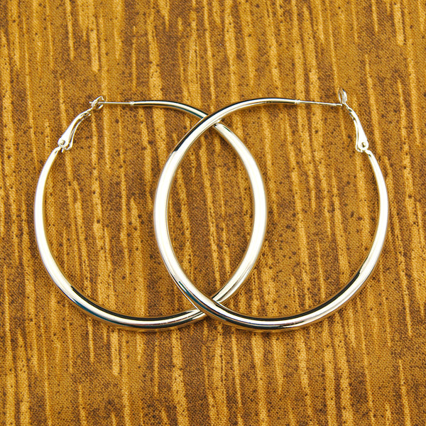 JS World Trading Oval Silver Hoop Earrings for sale at Cats Like Us - 3
