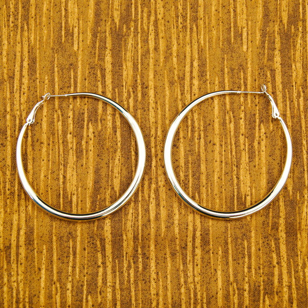 JS World Trading Oval Silver Hoop Earrings for sale at Cats Like Us - 1