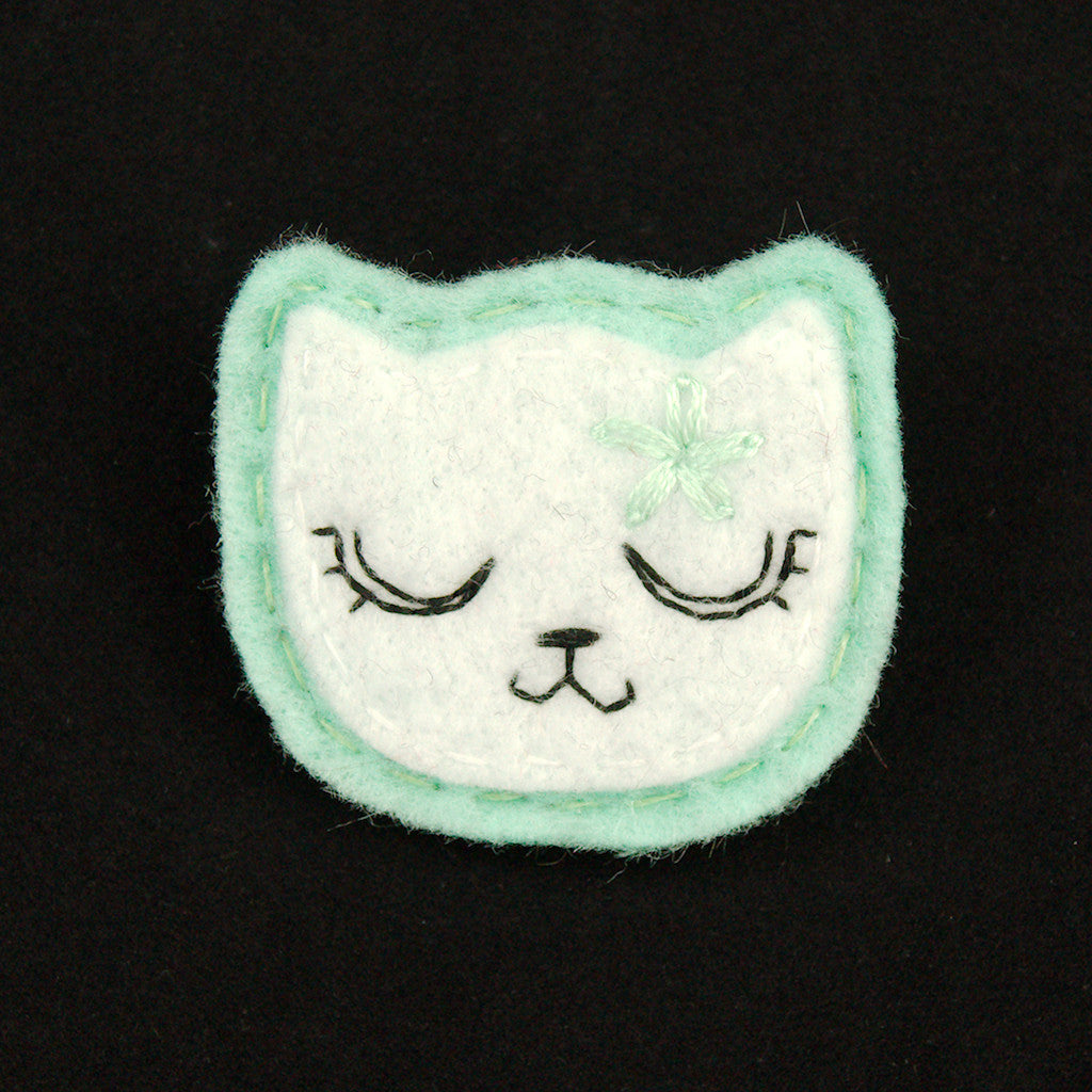 Lumpy Buttons White Kitty Pin in Girly Mint for sale at Cats Like Us - 1