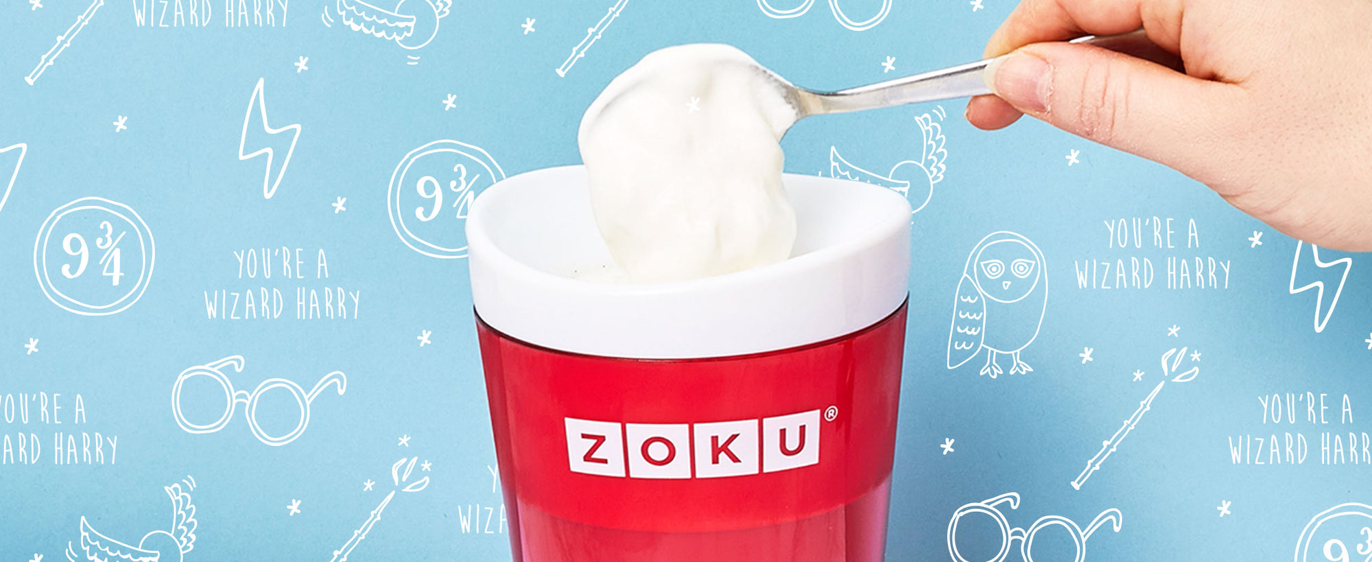 An image of ZOKU's Slush & Shake Maker with a hand spooning the topping onto a Homemade Frozen Butterbeer