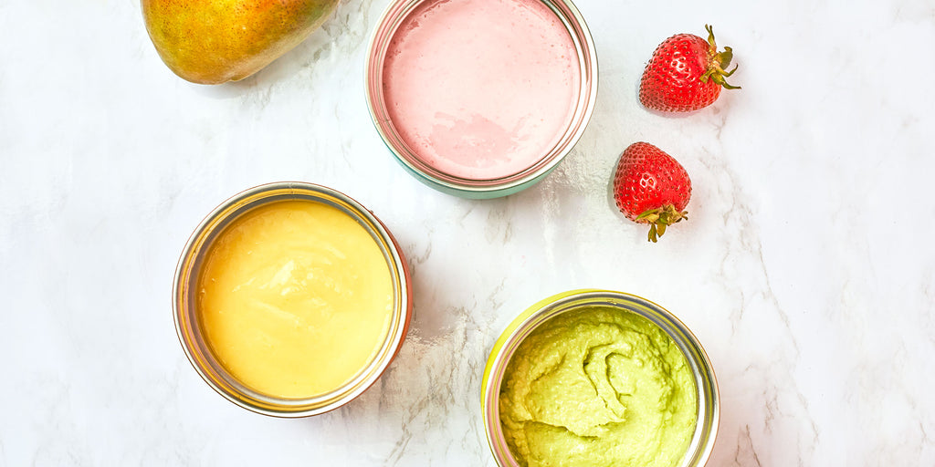 An image of various homemade baby food recipes in ZOKU's Neat Stack food containers and a Neat Stack Food Jar. The purees seen include an avocado puree for babies and a strawberry puree for babies.