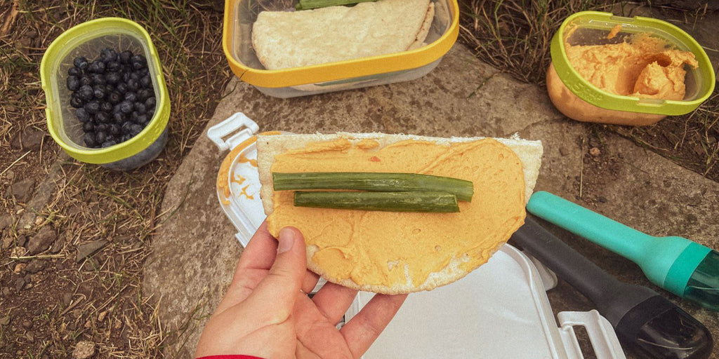 An image of a Hummus and Pita Lunch assembled using various ingredients which were transported using ZOKU's Neat Stack food containers.