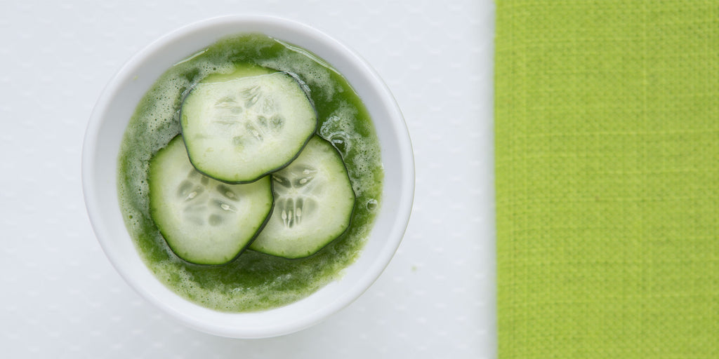 An overhead shot of ZOKU's Healthy Frozen Green Smoothie garnished with cucumber