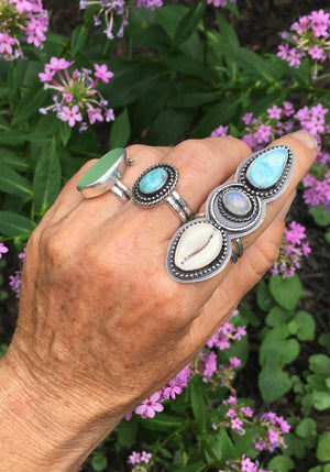 Alchemist Trio Ring with Larimar, Rainbow Moonstone and Cowrie Shell Shown on Hand