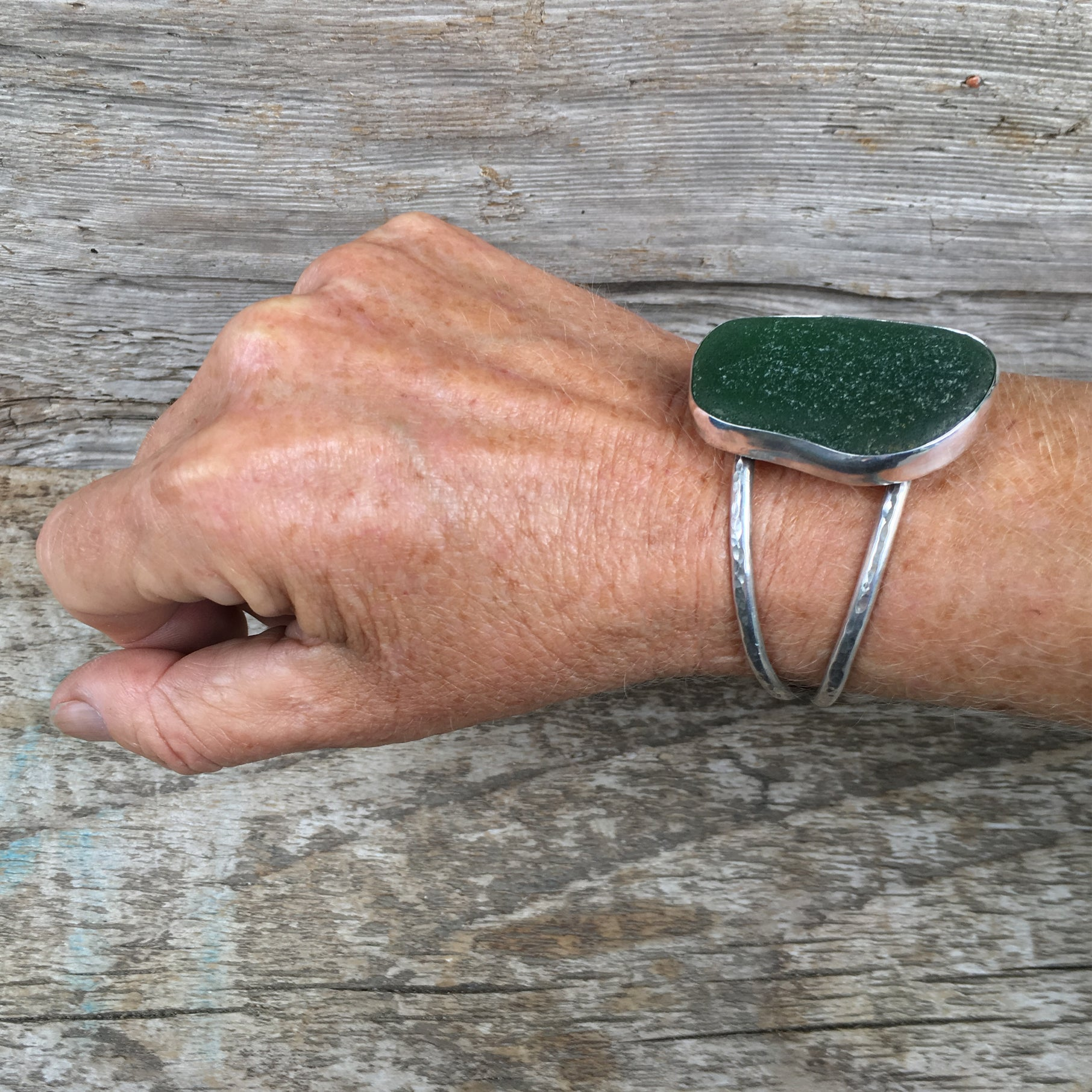 Luxe Beachcomber Cuff with Extra Large Deep Green Seaglass Shown on Wrist at Angle