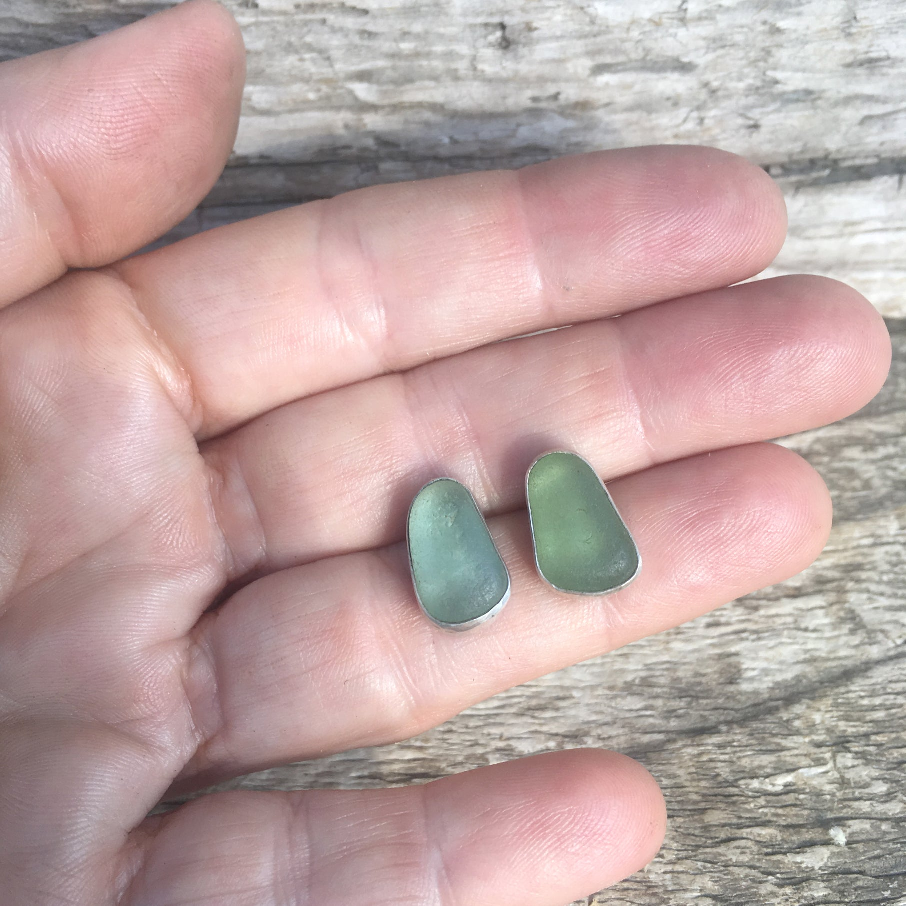 Seafoam Sea Glass Studs Shown in Hand