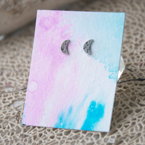 Crescent-Moon-Studs-On-Handmade-Watercolor-Paper-Textured