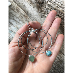 Wax and Wane Pendulum Hoops with Larimar and Sea Glass Shown in Hand