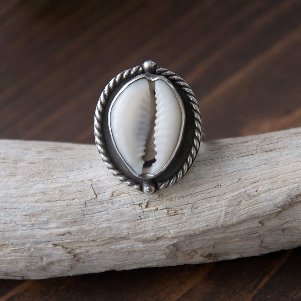 Nautical-Sterling-Silver-Cowry-Shell-Ring-on-Dark-Background