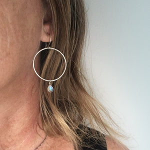 Organic-Handforged-Sterling-Silver-Hoops-With-Flashy-Rainbow-Moonstone-Shown-On-a-Model