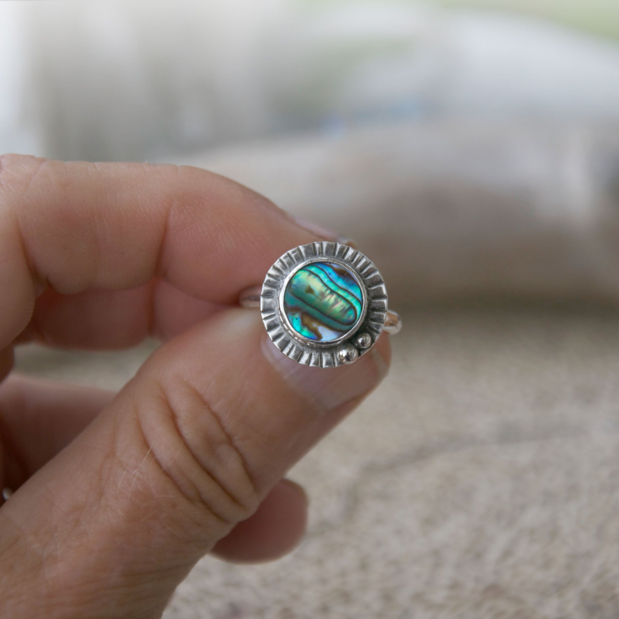 Rainbow-Ring-Abalone-Shell-and-Sterling-Silver-Held-for-Perspective
