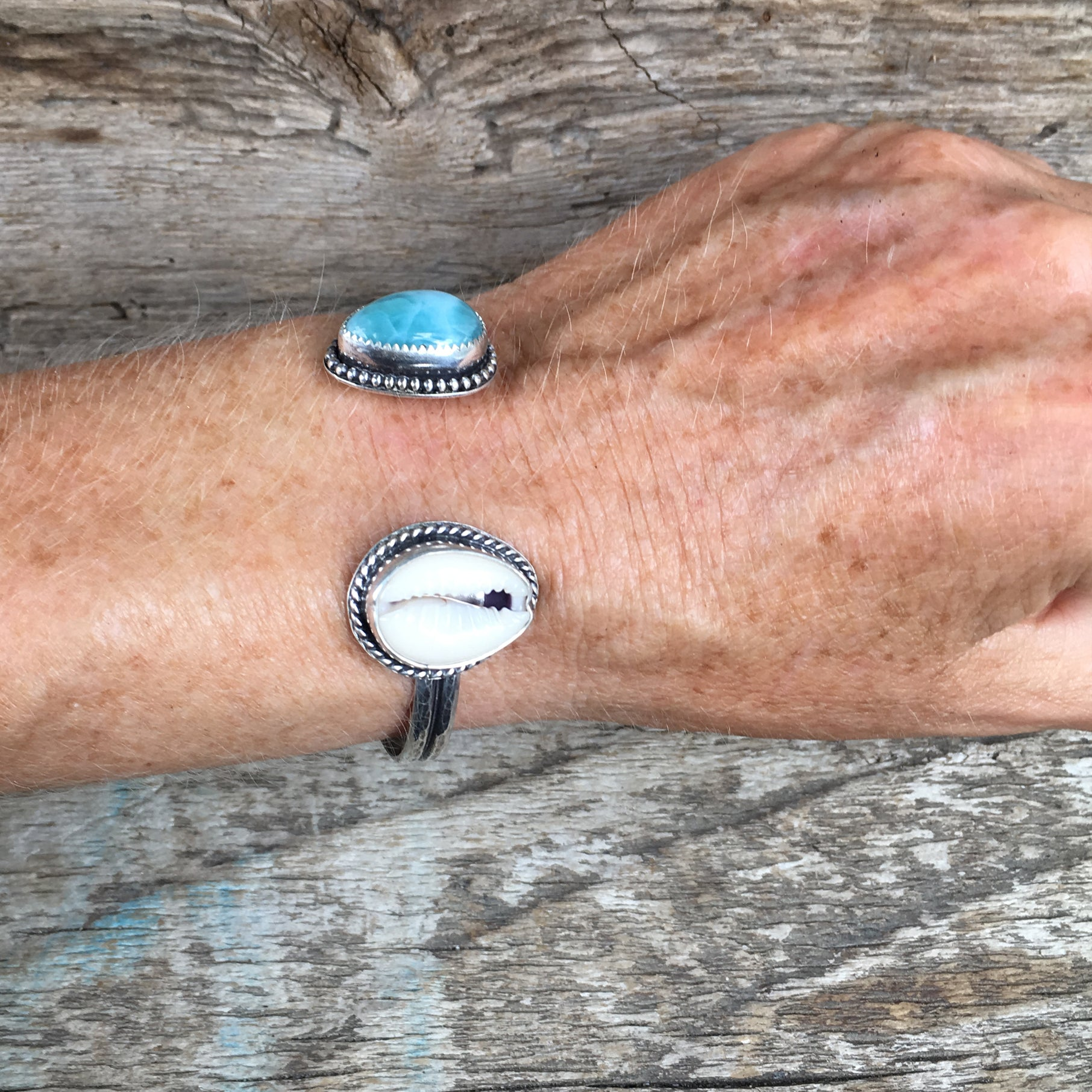 Two Treasures Cowry Shell and Larimar Cuff Shown on Hand