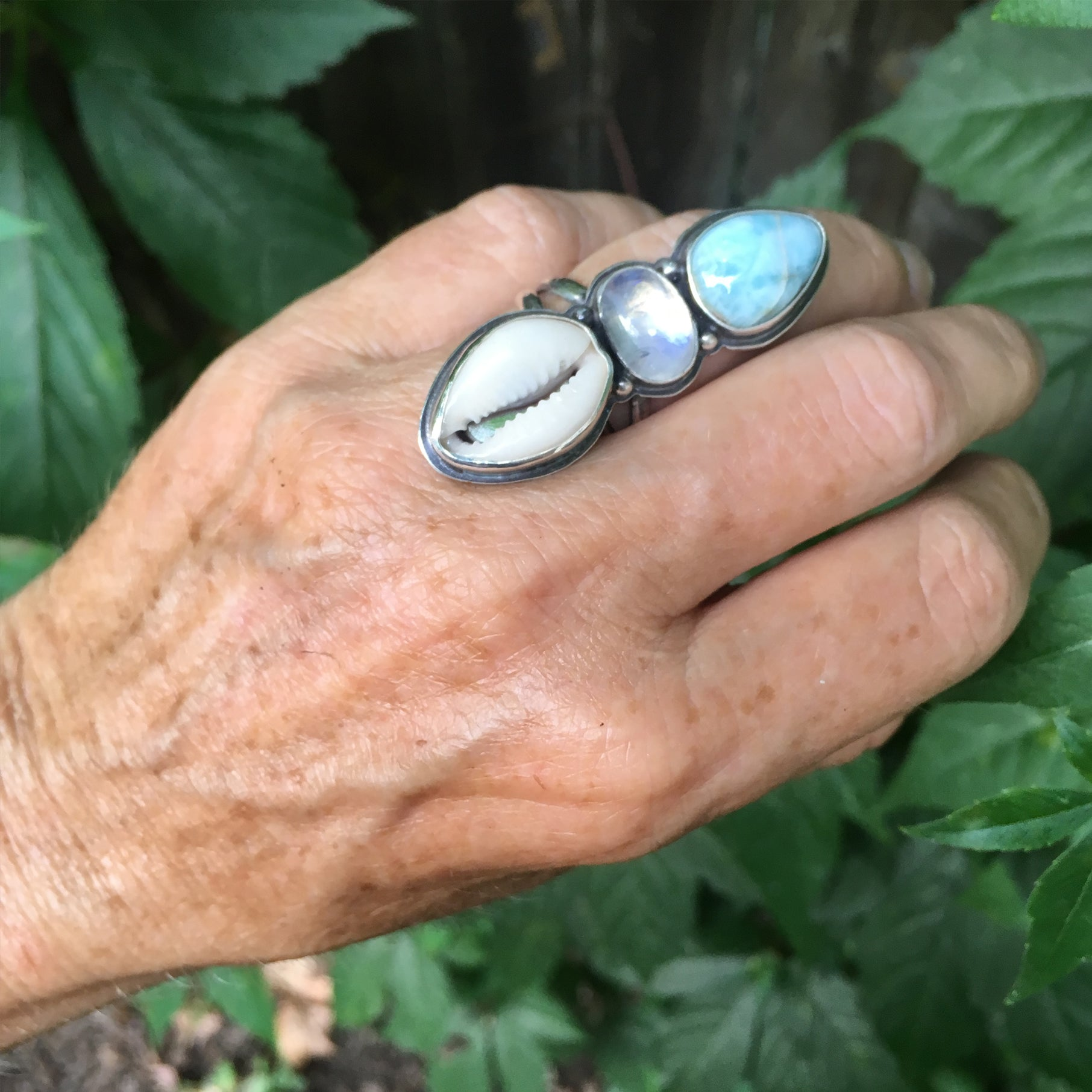 Traveler Trio Ring with Larimar, Rainbow Moonstone and Cowrie Shell Shown on Hand