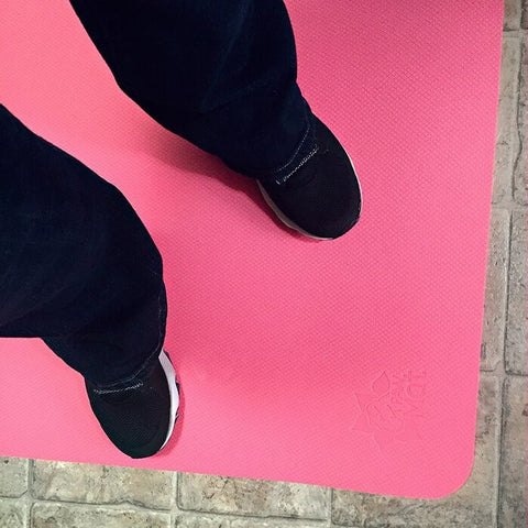 Person Standing on a Pretty in Pink PawMat Elite Floor Mat