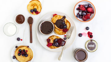 VEGAN PANCAKES WITH NUTTY CHOCOLATE DRIZZLE AND BERRIES