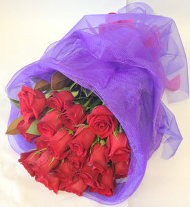 20 superb red roses with in mesh wrap