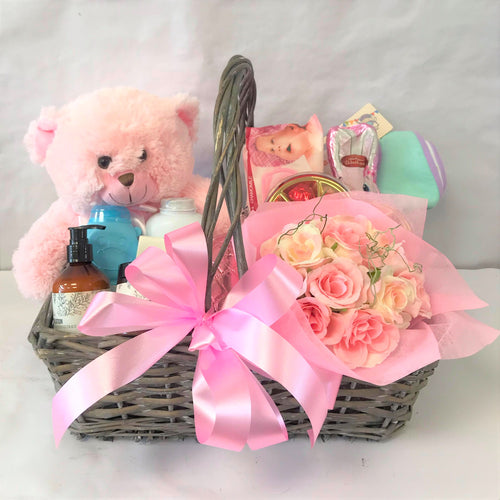 Goodie-filled gift basket for new Baby