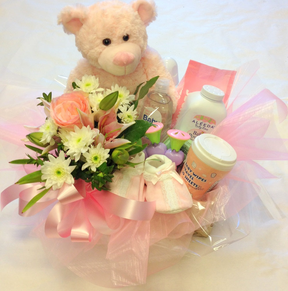 Baby basket with goodies for baby girl