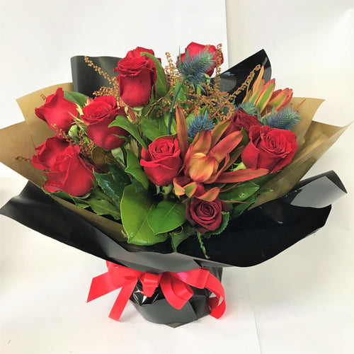 9 Red Roses with Other Foliage