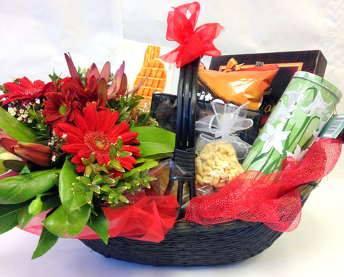 Flowers and gourmet treats in basket