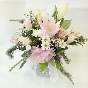 Handtied bouquet in glass vase