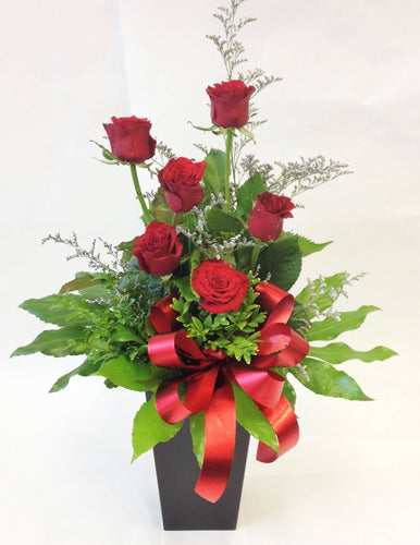 6 red roses in waterbox