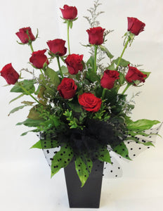 12 red roses in a water box