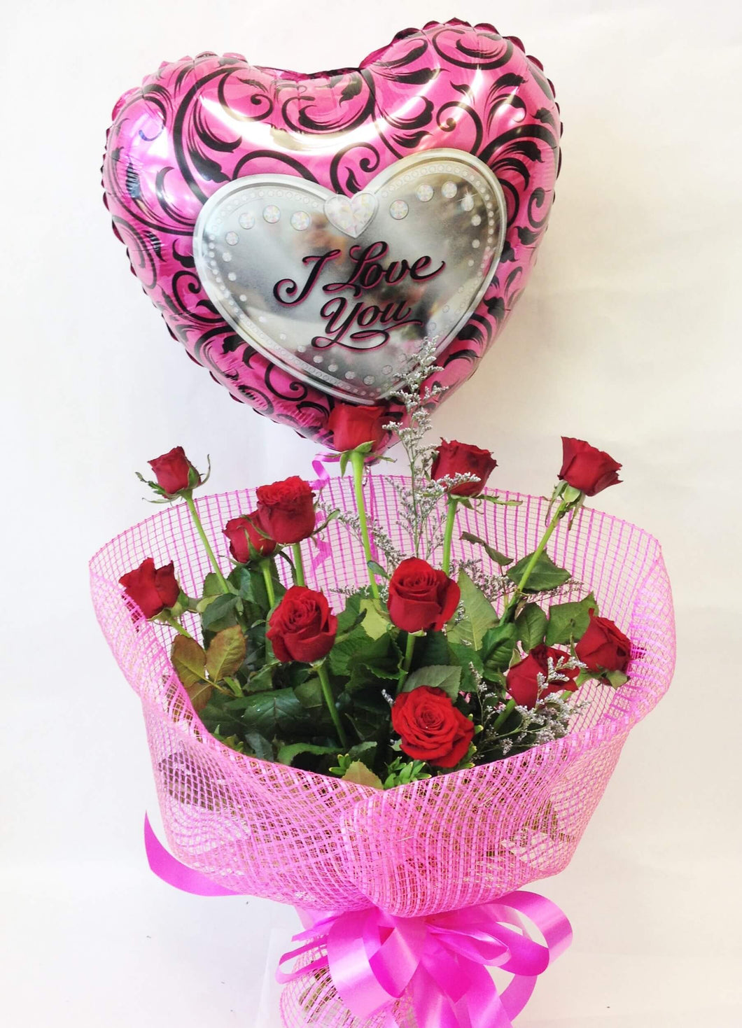 12 roses in hot pink with a helium balloon