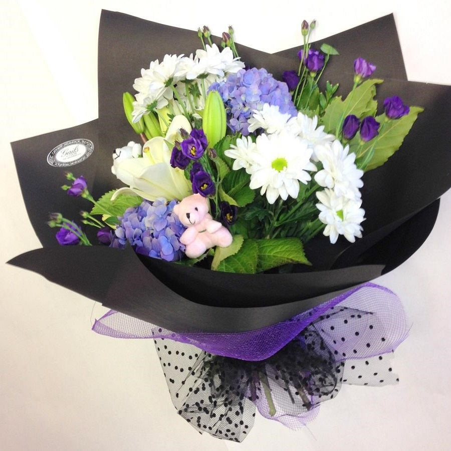 Purple and white hand-tied in black wrap