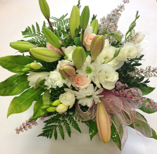 Boxed bouquet of pink and white small flowers