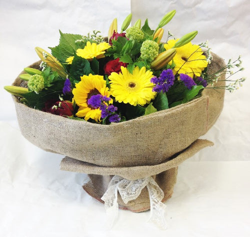 Flowers wrapped in vintage hessian, Gerberas, lillies, Chrysanthemums, Seasonal blooms, bouquet flowers,