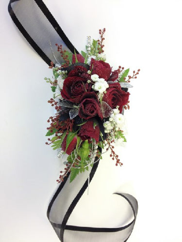 Mini red rose corsage for black gown