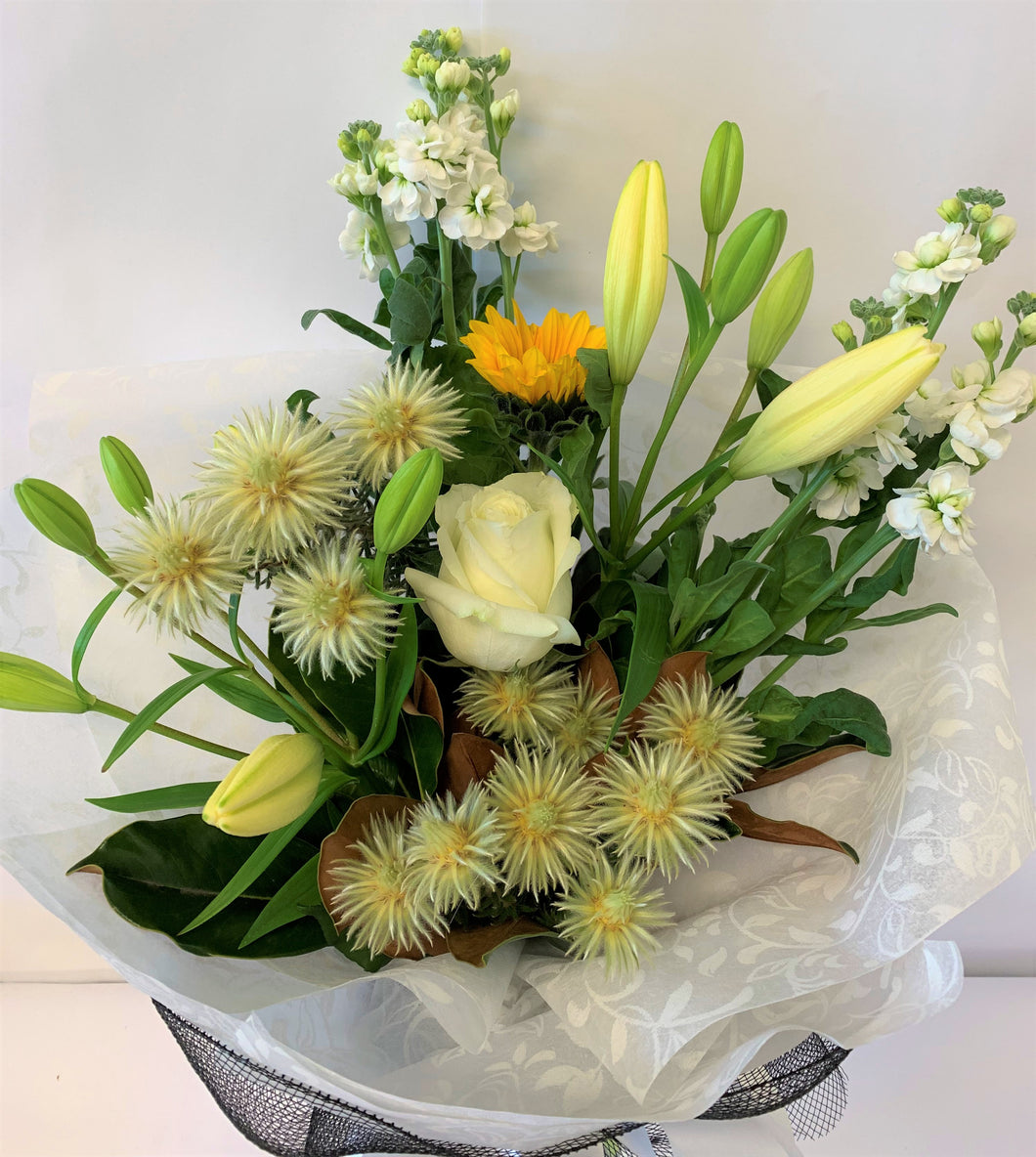Green, white and yellow hand-tied flowers for sympathy or get well      Delivery throughout New Zealand
