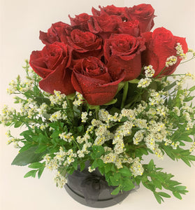 12 Beautiful red roses in water in a decorative box for your special friend or lover for Valentines day.