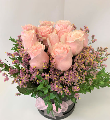 12 Beautiful pink roses in water in a decorative box for your special friend or lover for Valentines day.      Delivery in Hamilton or Throughout New Zealand.