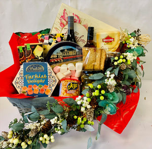 Basket or box with two wines, large chocolates, Large Christmas cake, gherkins, nuts, Biscuits, Turkish delight, Miccona coffee, Biscotti, Marshmellows, liquorice all sorts Toasties, Chips, Large tin or biscuits, Garland wreath or Gift.