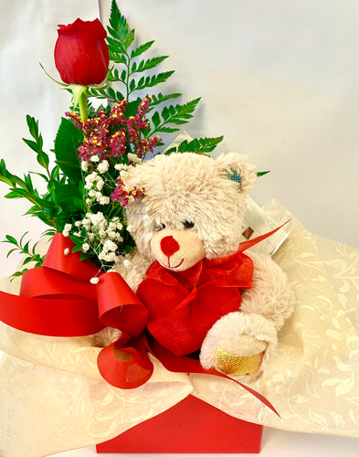 Chocolates, teddy-bear and rose in a box