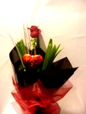 Single rose with chocolate heart