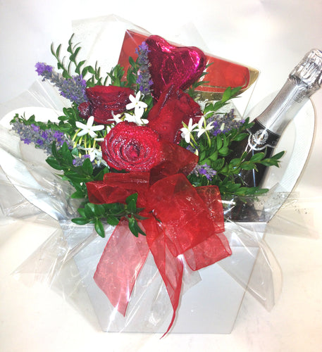 Box with wine with chocolates and flowers