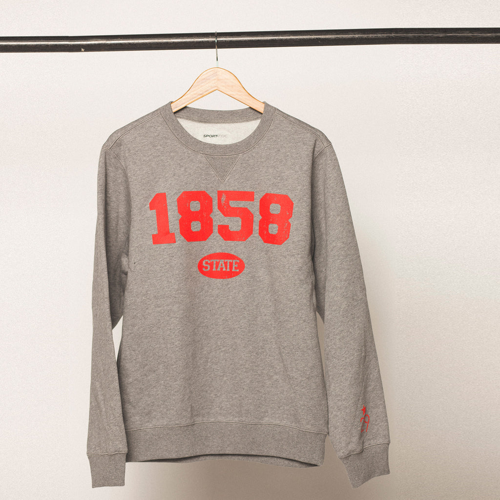 vintage heather grey sweatshirt with bright red bold screenprinted lettering featuring the established year 1858 for iowa state university in ames iowa