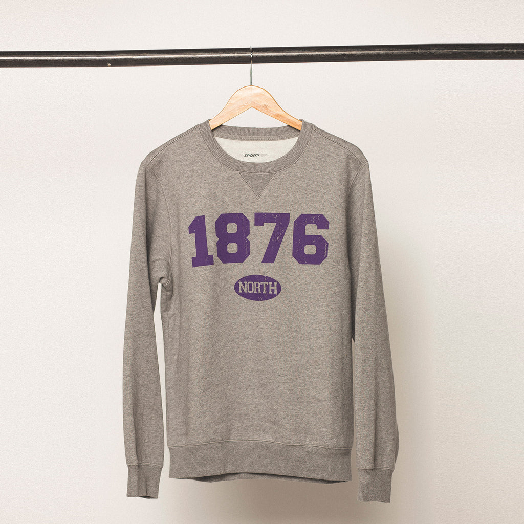 vintage heather grey sweatshirt with purple bold screen printed lettering featuring the established year 1876 for the university of northern iowa in cedar falls iowa