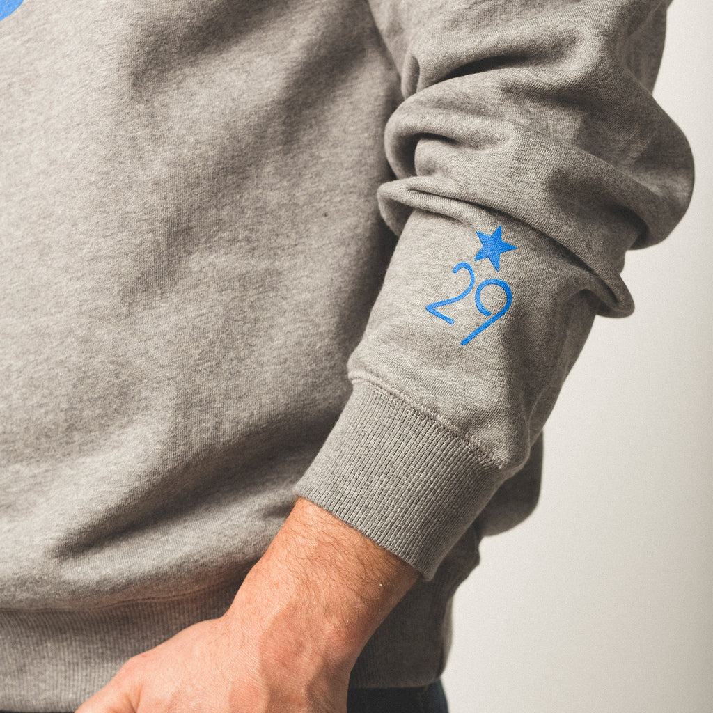 vintage heather grey sweatshirt with 29th State Apparel logo on left sleeve right above the wrist cuff