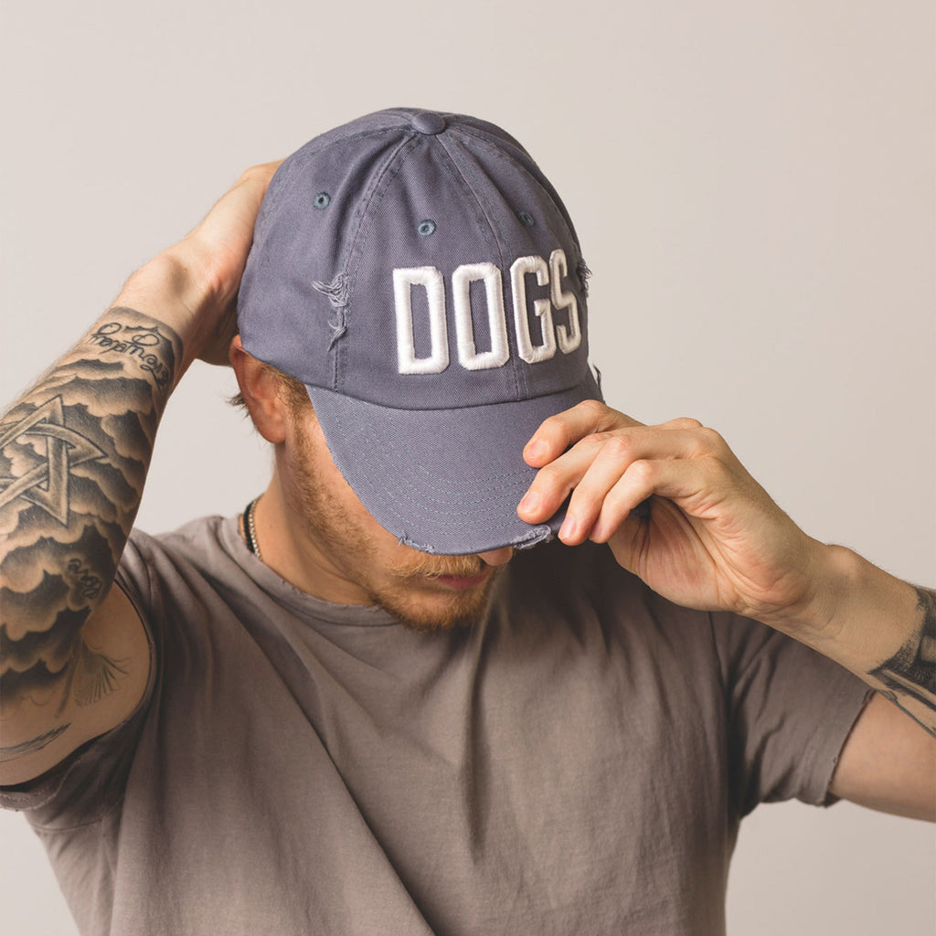 male adjusting dogs distressed blue baseball hat