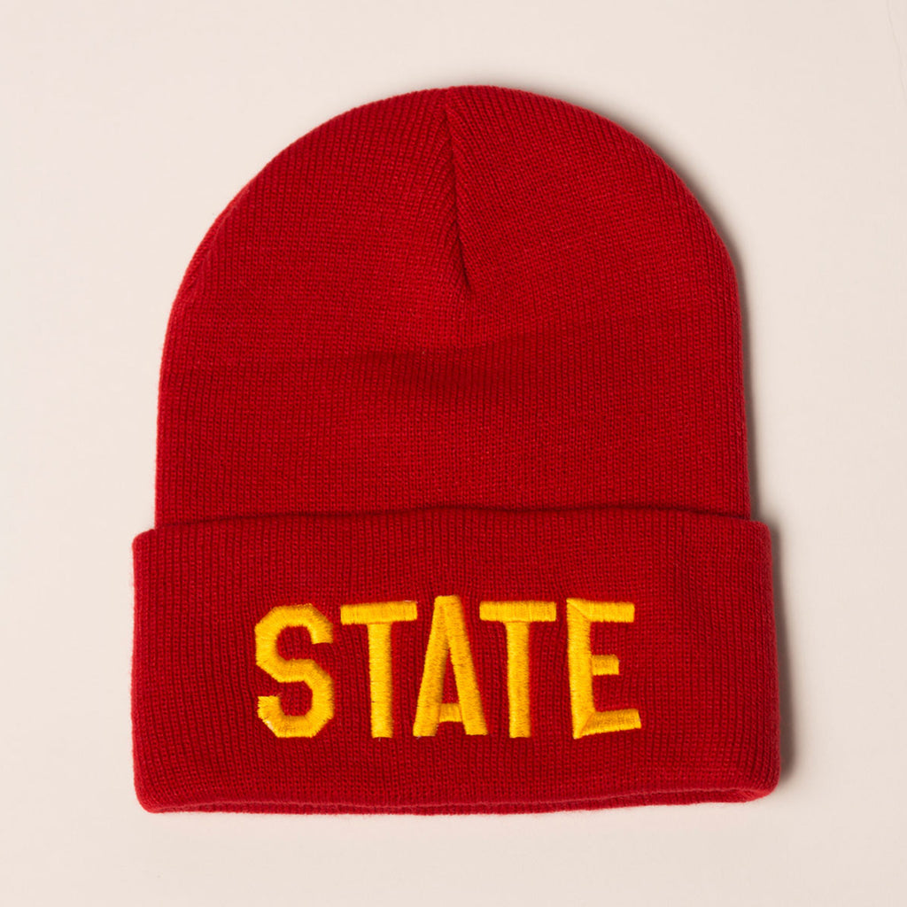 red beanie with folding cuff state in gold on front center