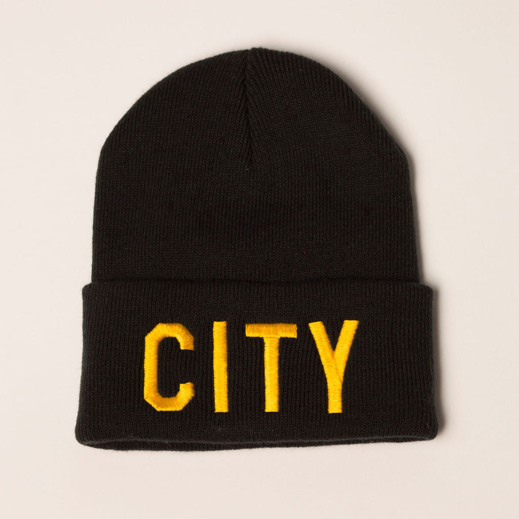 black beanie folding cuff city on front in gold bold lettering