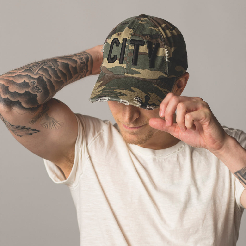 front view on model CITY Distressed Baseball Hat camo