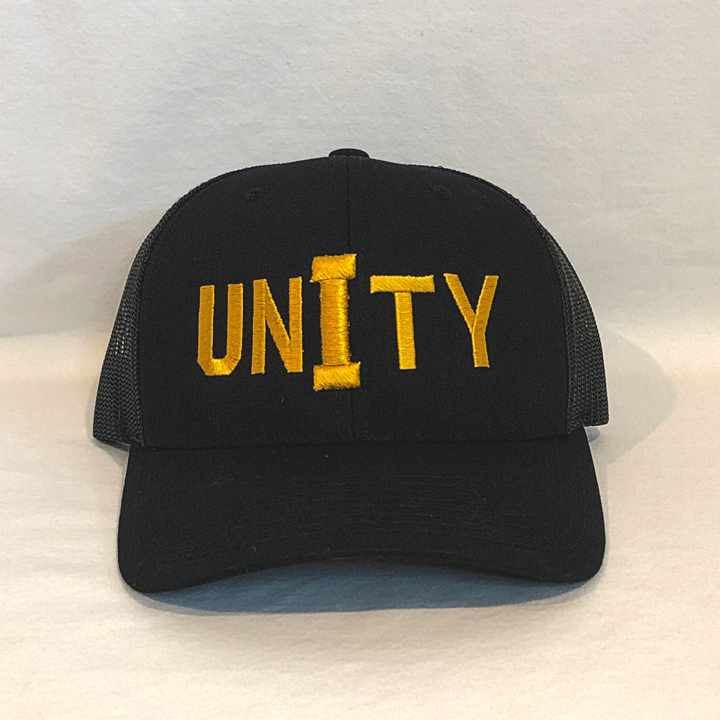 unity in gold on an all black trucker hat